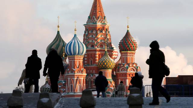 FILE PHOTO:  People walk in Red Square, with St. Basil's Cathedral seen in the background, in Moscow