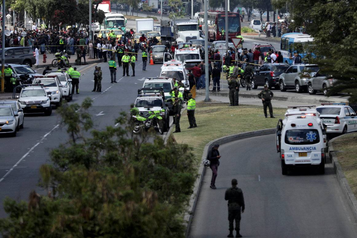 Police and security personnel work at the scene where a car bomb exploded, according to authorities, in Bogota
