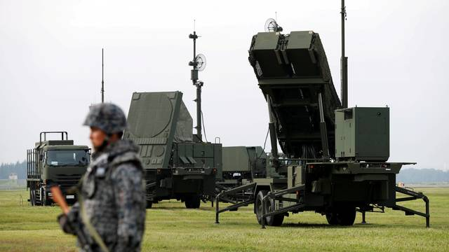 FILE PHOTO: JSDF soldier takes part in a drill to mobilise their PAC-3 missile unit in response to recent missile launch by North Korea, at U.S. Air Force Yokota Air Base in Fussa