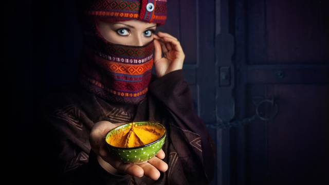 Woman in turban with yellow spice