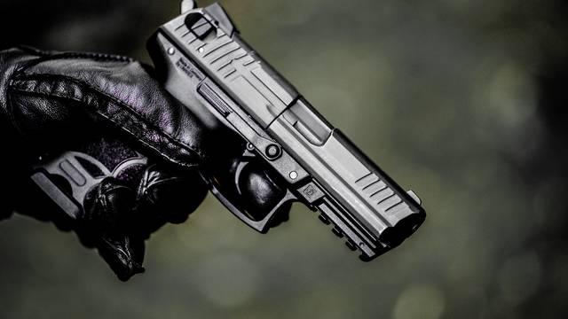 A man with a submachine gun