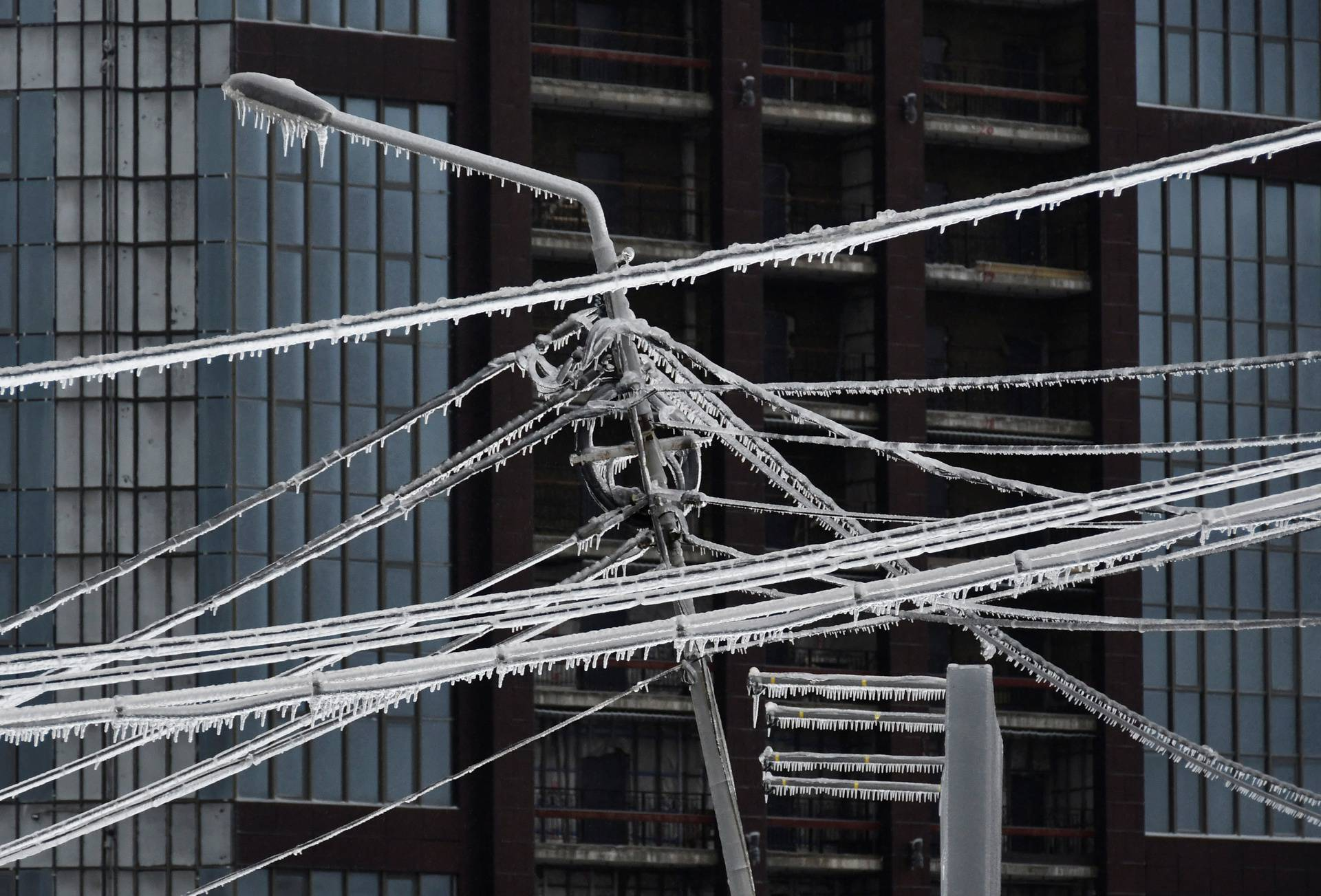 Ice-covered power lines and a light pole are pictured after freezing rain in Vladivostok