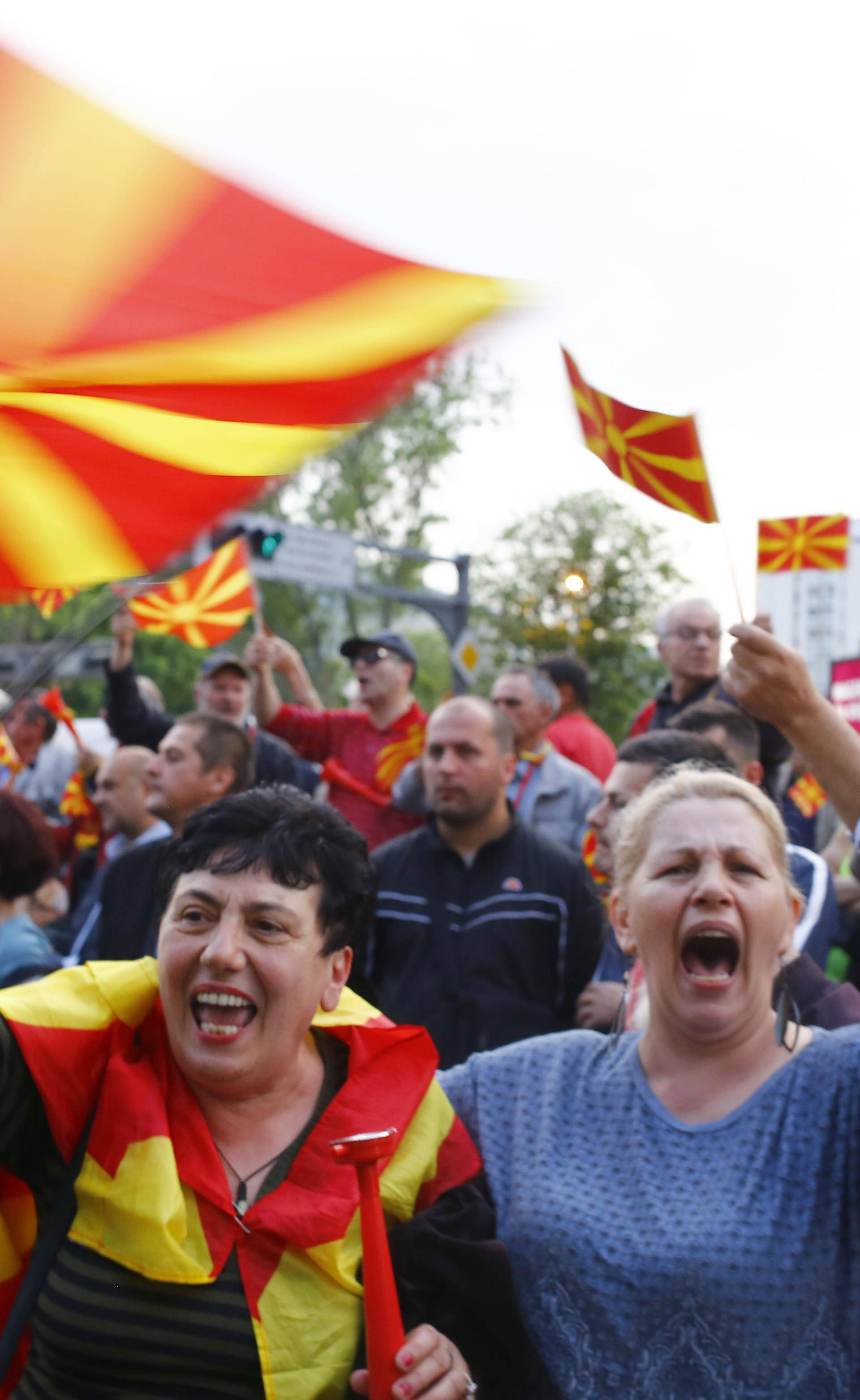 Protesters demonstrate in front of the EU Info Center building in Skopje