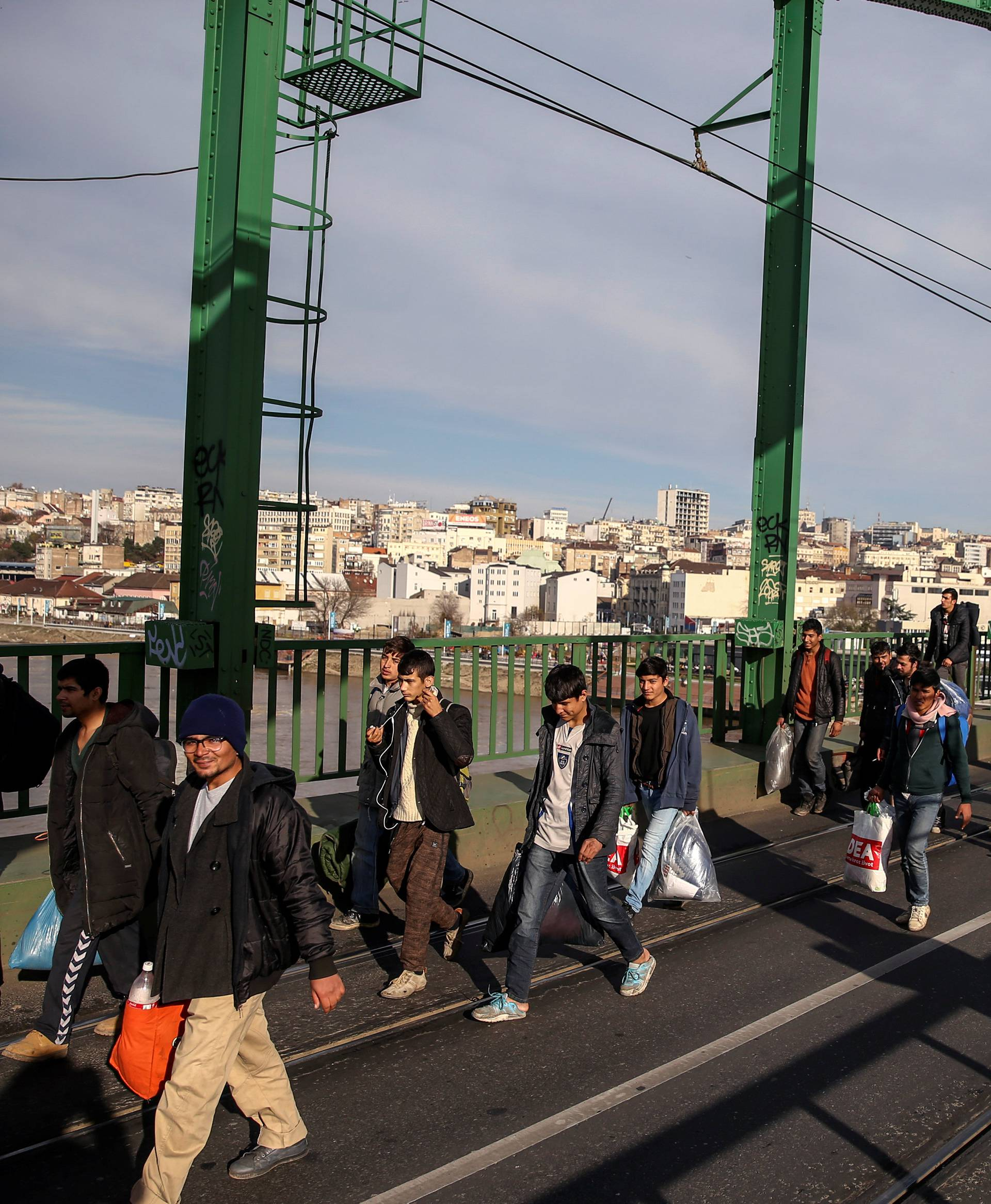 Refugees and migrants cross the Old Sava Bridge heading in the direction of the Croatian border, in Belgrade