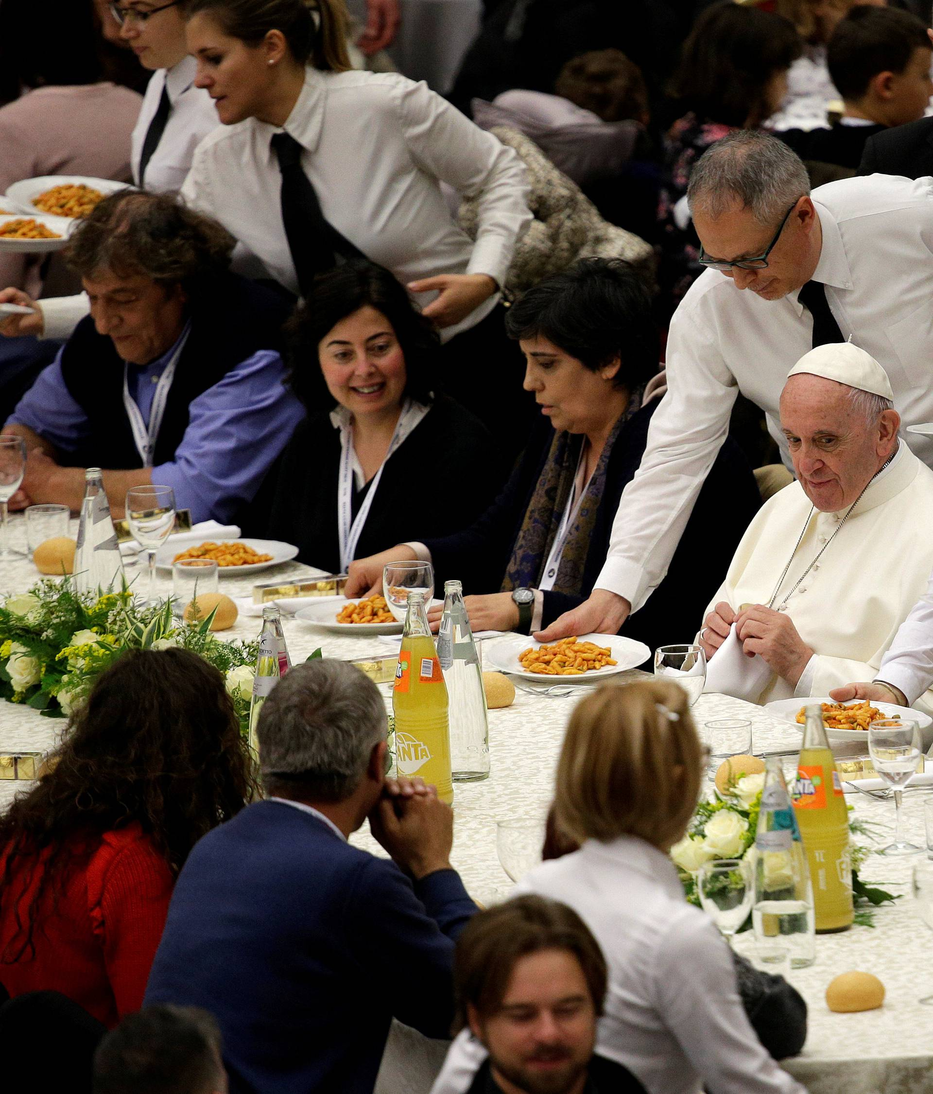 Pope Francis has lunch with the poor following a special mass to mark the new World Day of the Poor in Paul VI's hall at the Vatican