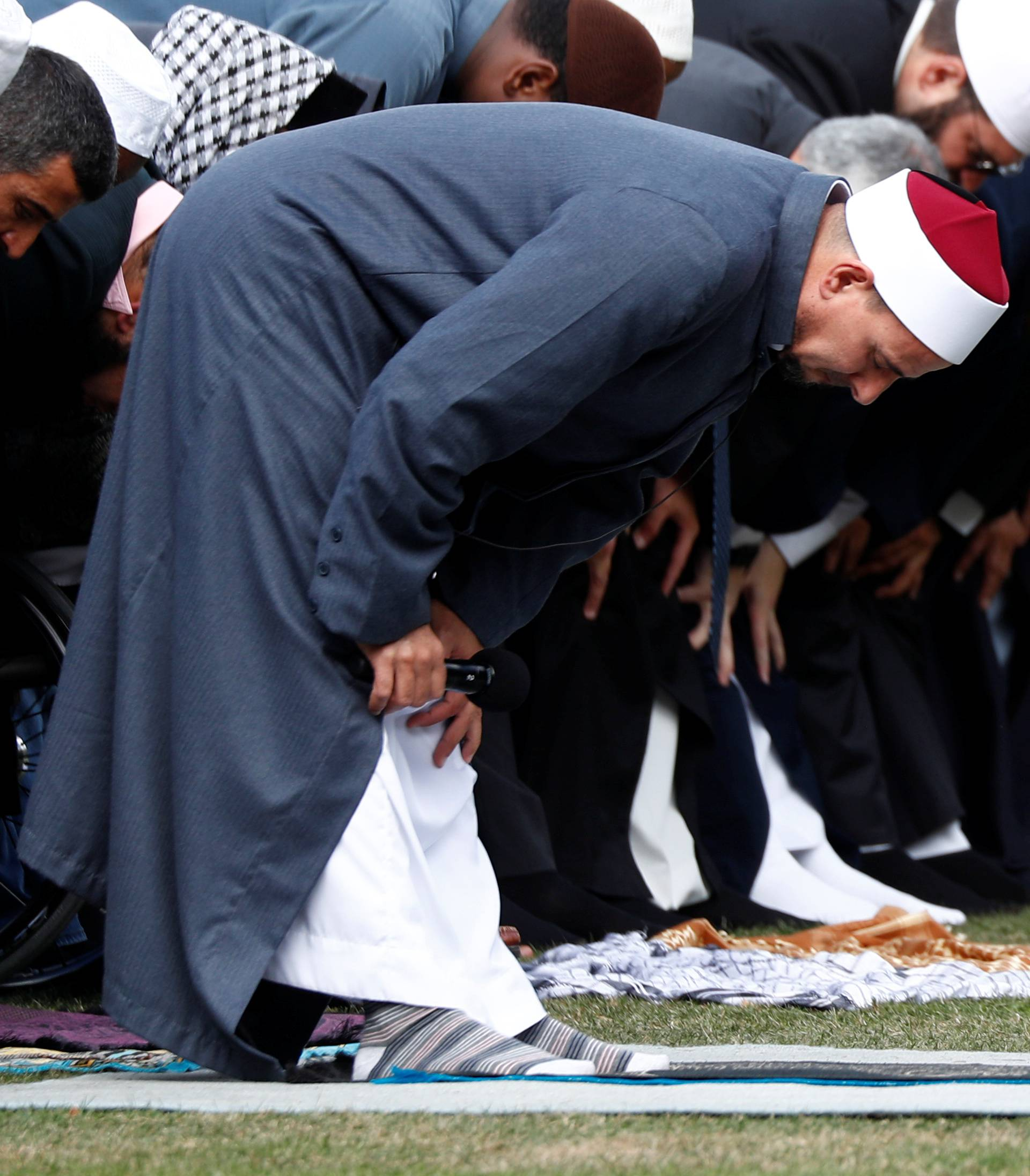 Imam Gamal Fouda leads a Friday prayer at Hagley Park outside Al-Noor mosque in Christchurch, New Zealand