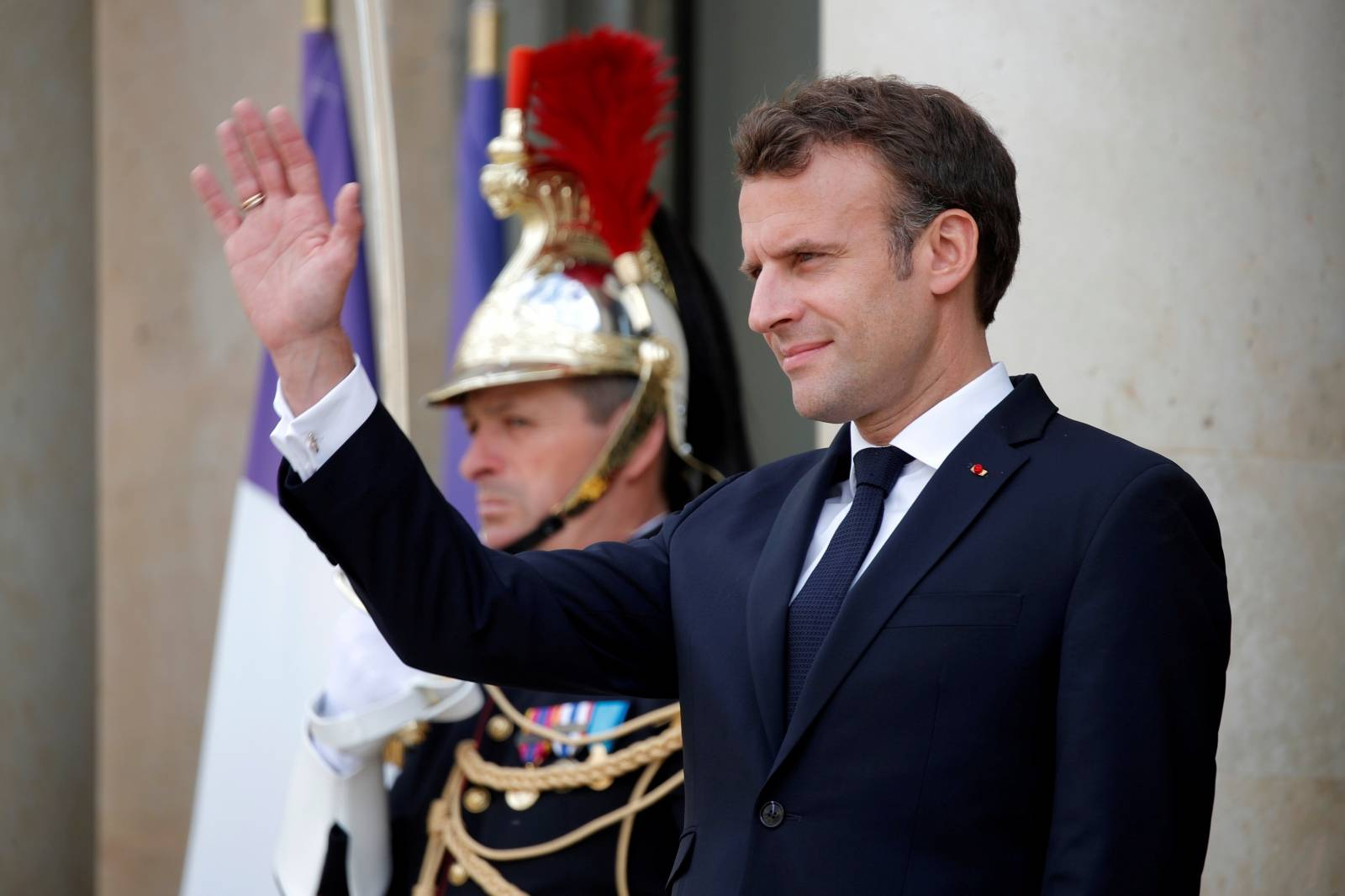FILE PHOTO: French President Emmanuel Macron waves at the Elysee Palace in Paris
