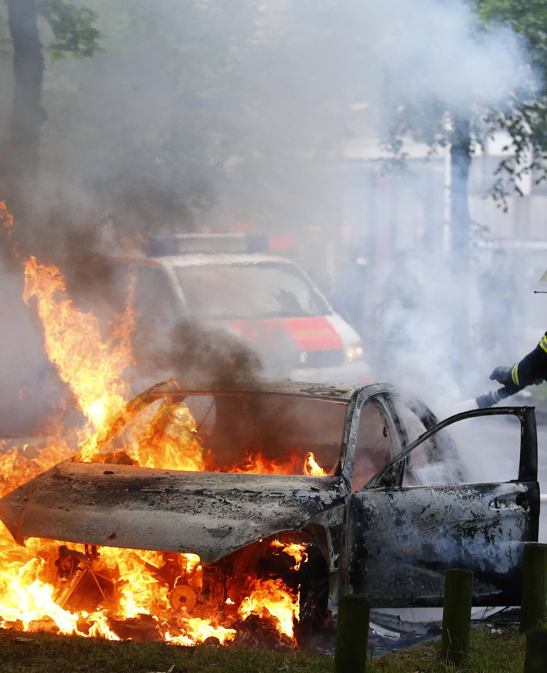 Firefighter works at the scene where a number of cars burnt down during the G20 summit in Hamburg