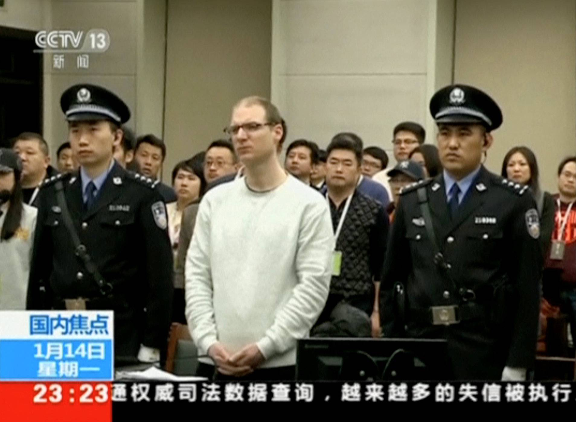 A still image taken from CCTV video shows Canadian Robert Lloyd Schellenberg in court, where he was sentenced with a death penalty for drug smuggling, in Dalian