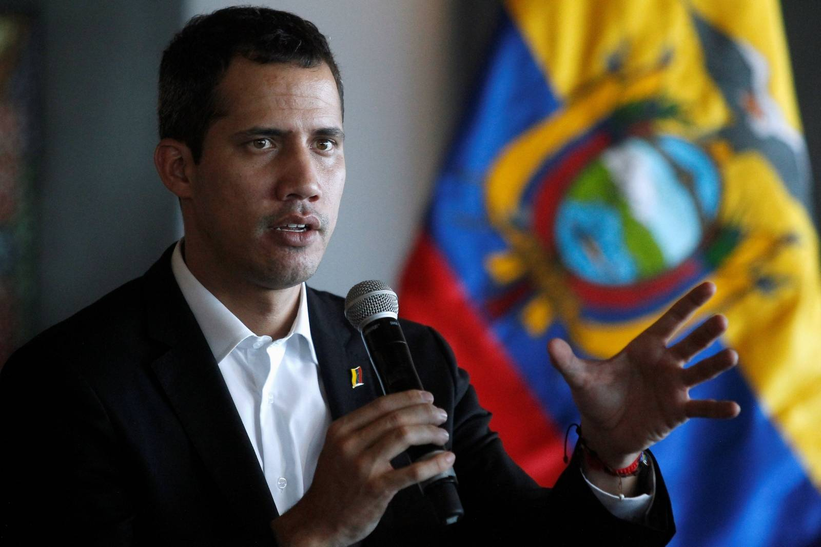 Venezuelan opposition leader Juan Guaido, who many nations have recognized as the country's rightful interim ruler, speaks during a meeting with Ecuador's President Lenin Moreno (not pictured) in Salinas