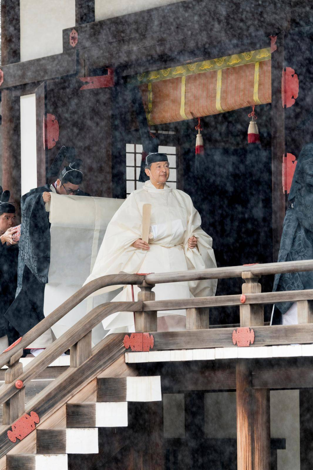 This handout photo taken and released by the Imperial Household Agency of Japan on October 22, 2019 shows Japan's Emperor Naruhito leaving Kashikodokoro sanctuary