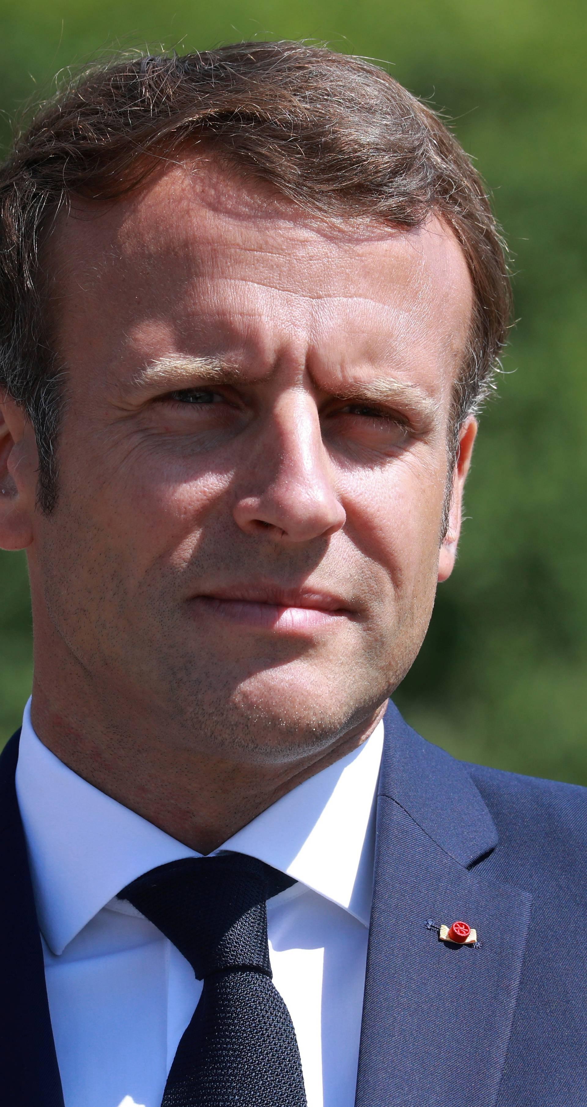 French President Emmanuel Macron visits a factory of manufacturer Valeo, in Etaples