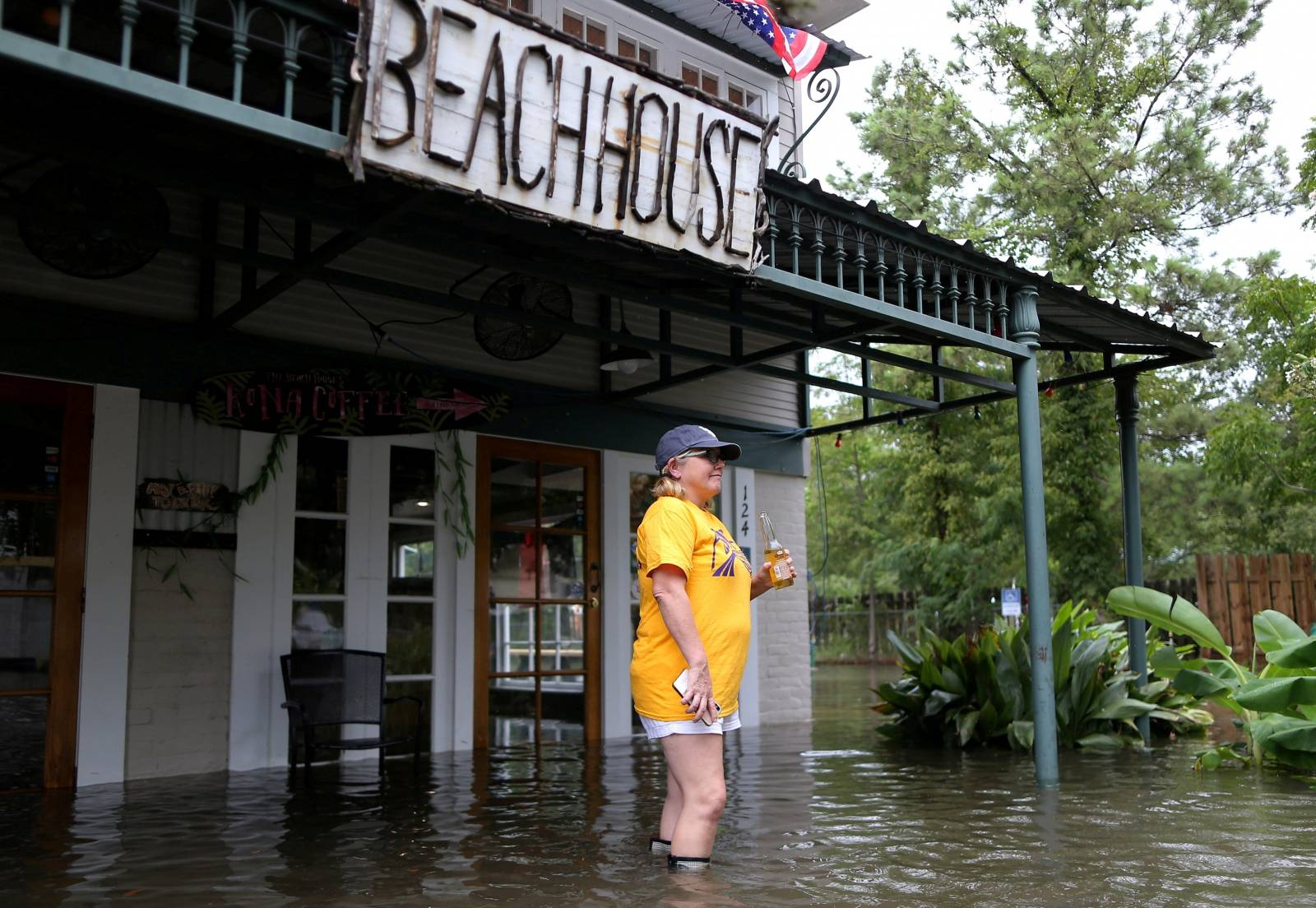 Robyn Iacona-Hilbert stands outside her flooded business after Hurricane Barry in Mandeville