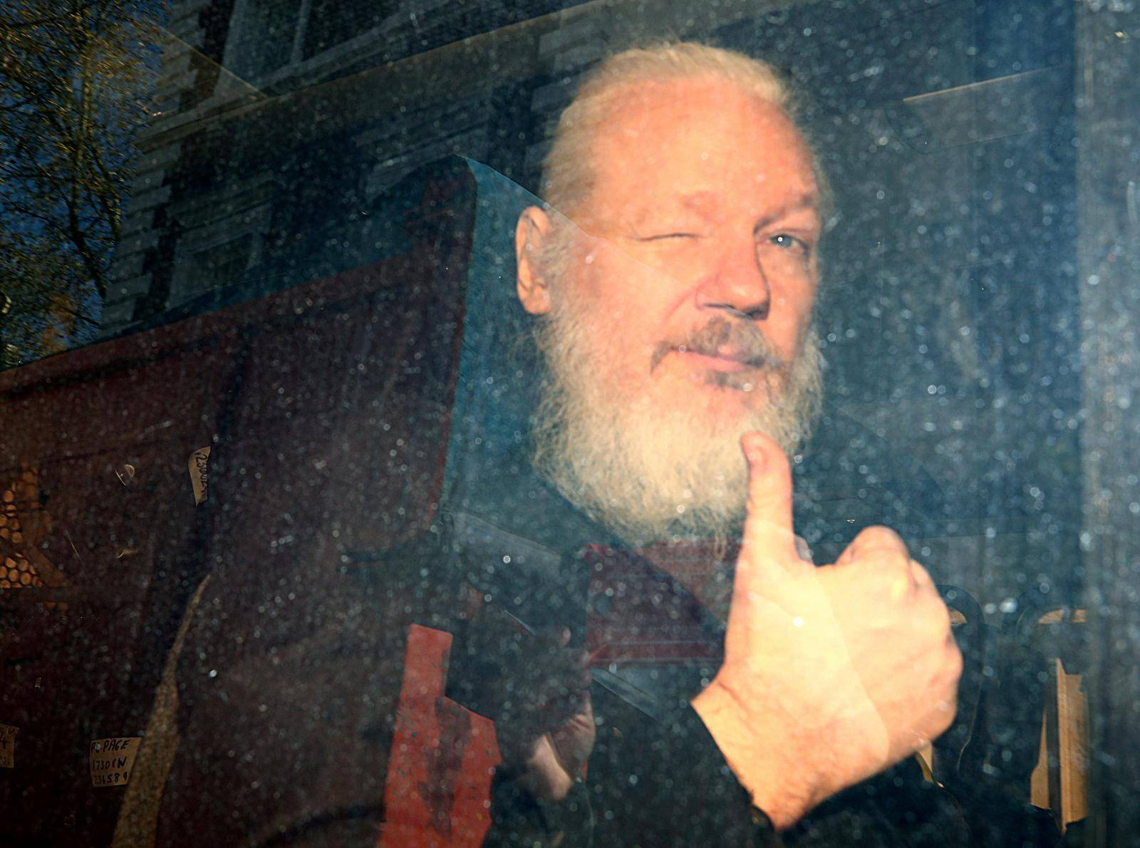 FILE PHOTO: WikiLeaks founder Julian Assange arrives at the Westminster Magistrates Court, after he was arrested  in London