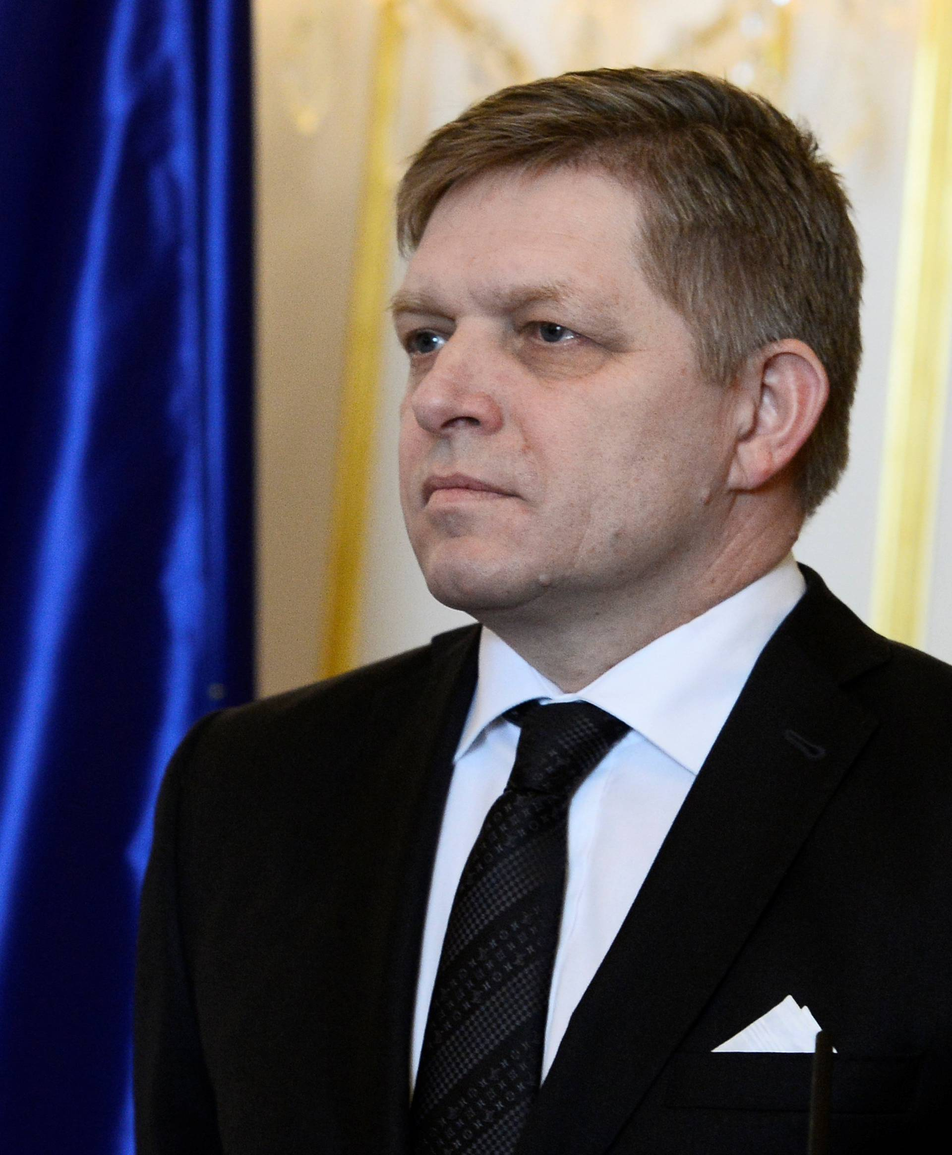 Slovakia's Prime Minister Robert Fico reacts after a meeting of Slovakia's three top officials at the Bratislava castle