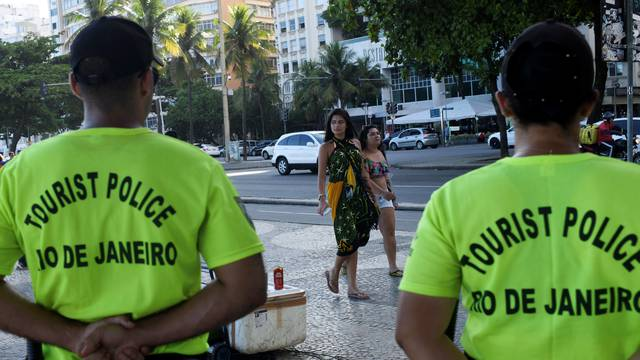 Tourist police officers stand guard at the Copacabana beach in Rio de Janeiro