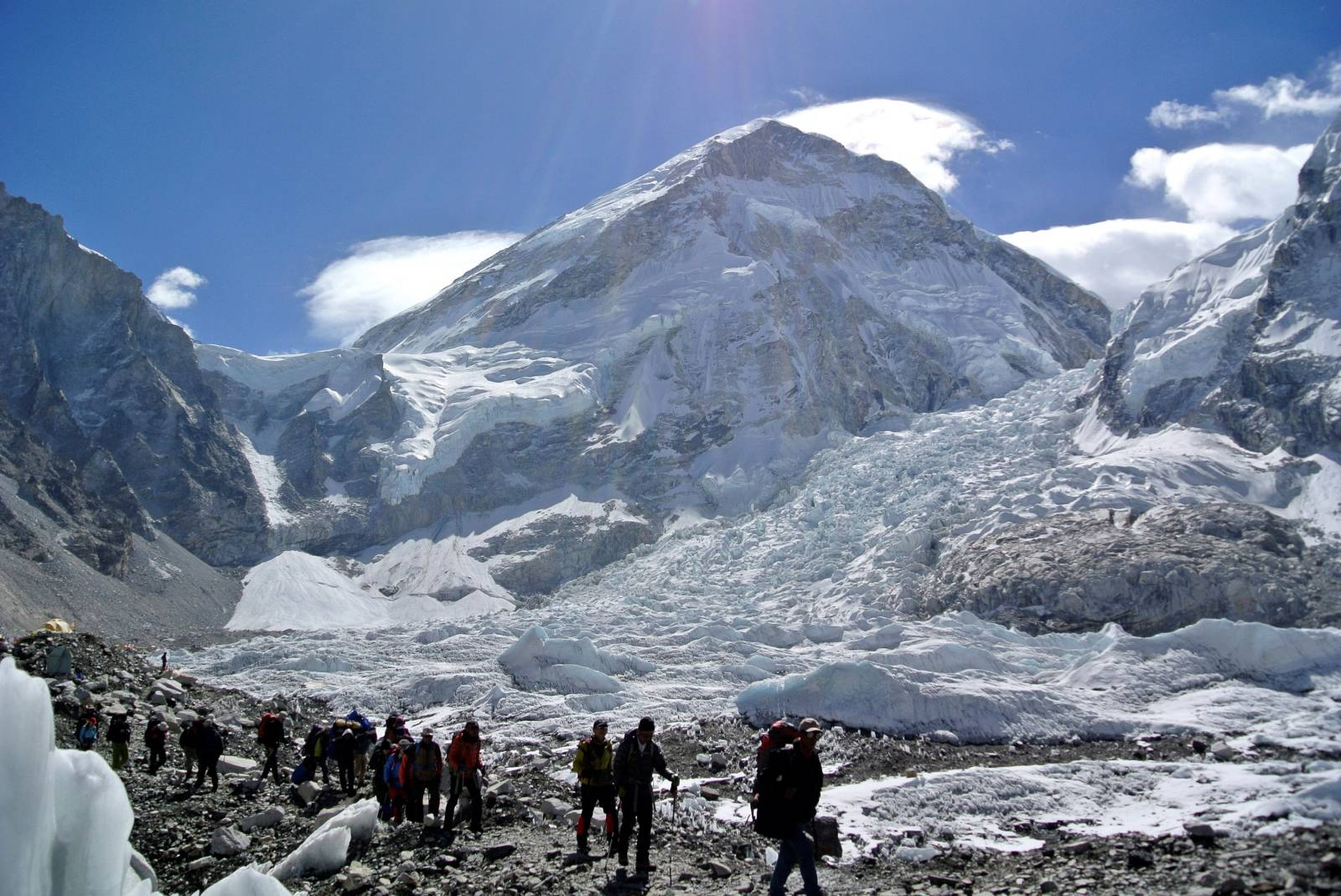 FILE PHOTO: Climbers walk towards their helicopter after their Mount Everest expeditions were cancelled