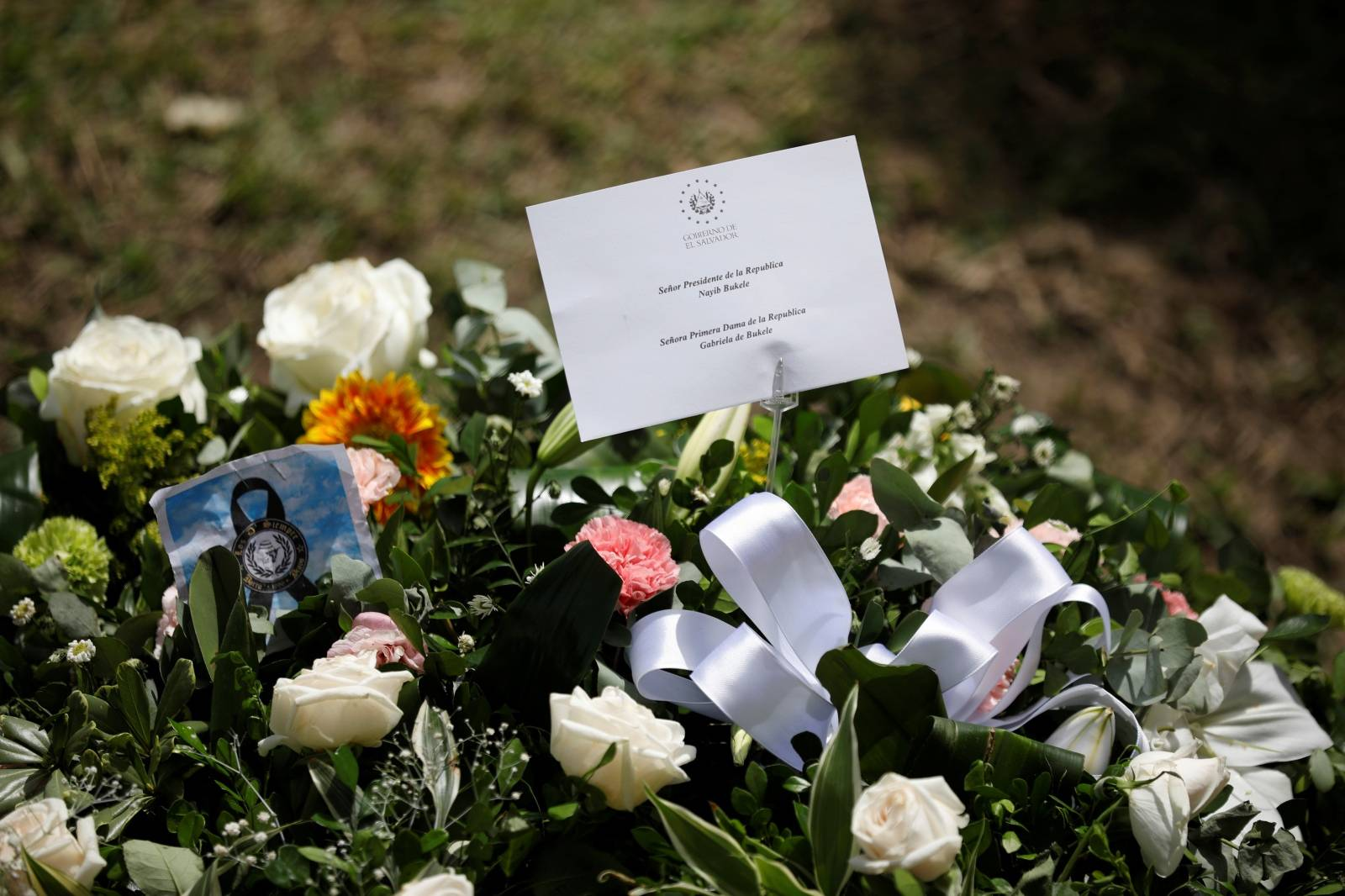 Flowers sent on behalf of the President of El Salvador, Nayib Bukele, and the first lady, Gabriela de Bukele, are seen at La Bermeja cemetery, where Oscar Alberto Martinez Ramirez and his daughter Valeria were buried in San Salvador