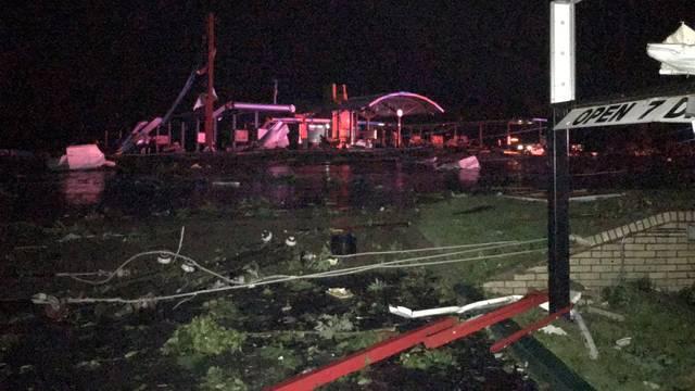 Damage is seen on a street after a tornado in Jefferson City