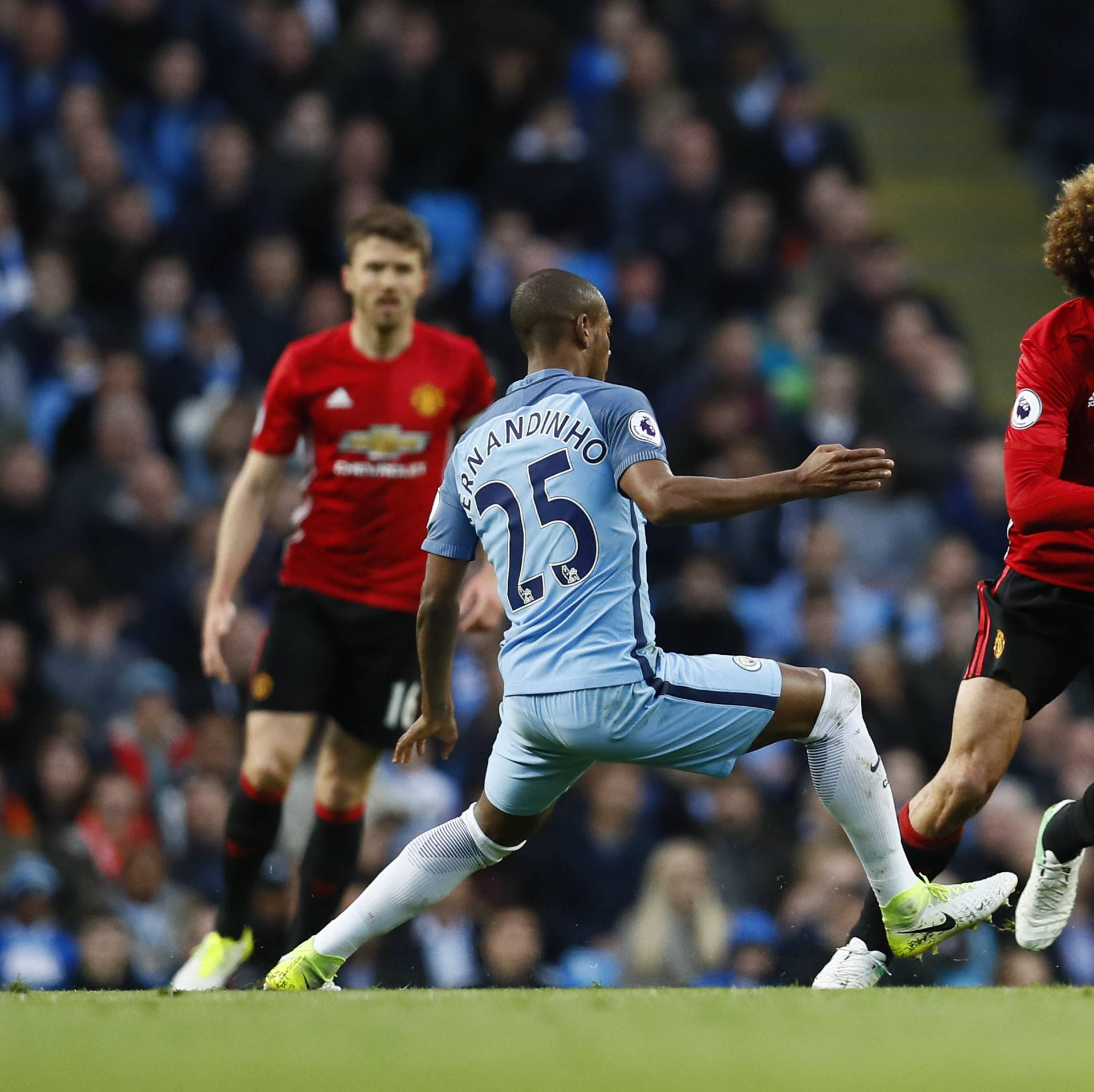 Manchester City's Fernandinho in action with Manchester United's Marouane Fellaini