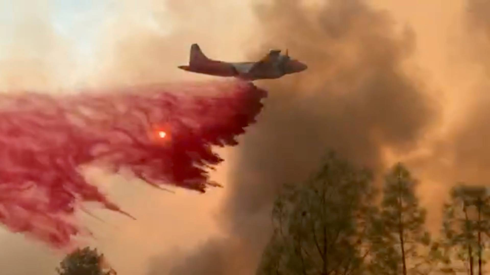 Fire retardant is dropped on a lightning complex fire in Berryessa Estates