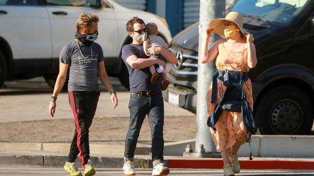 *EXCLUSIVE* Elijah Wood goes for a stroll with his baby and actor pal Dominic Monaghan