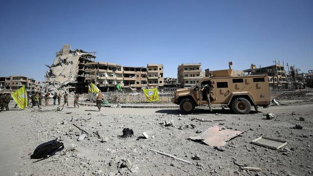 Fighters of Syrian Democratic Forces are seen in Raqqa