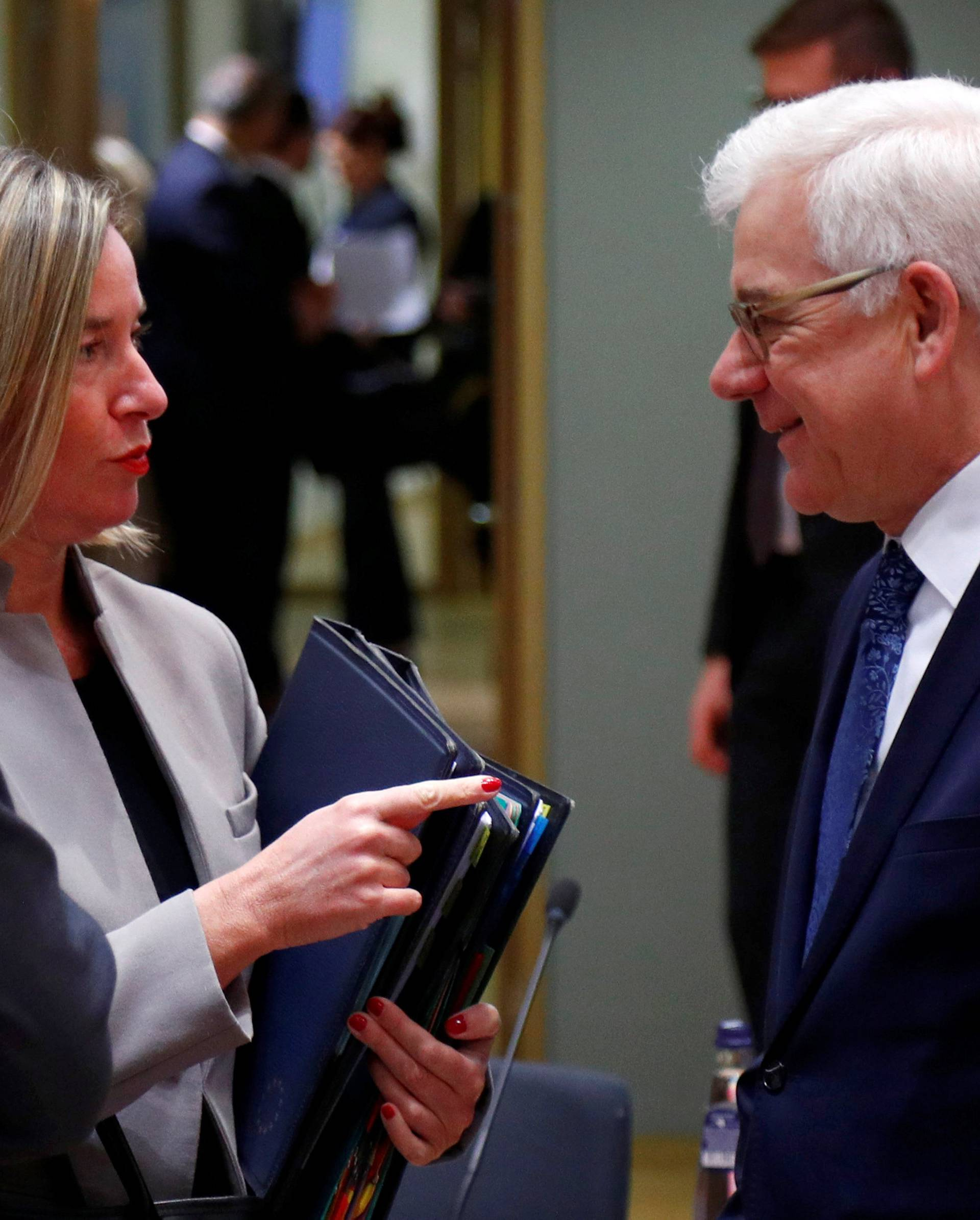 EU foreign policy chief Mogherini talks to Poland's Foreign Minister Czaputowicz during EU foreign ministers meeting in Brussels