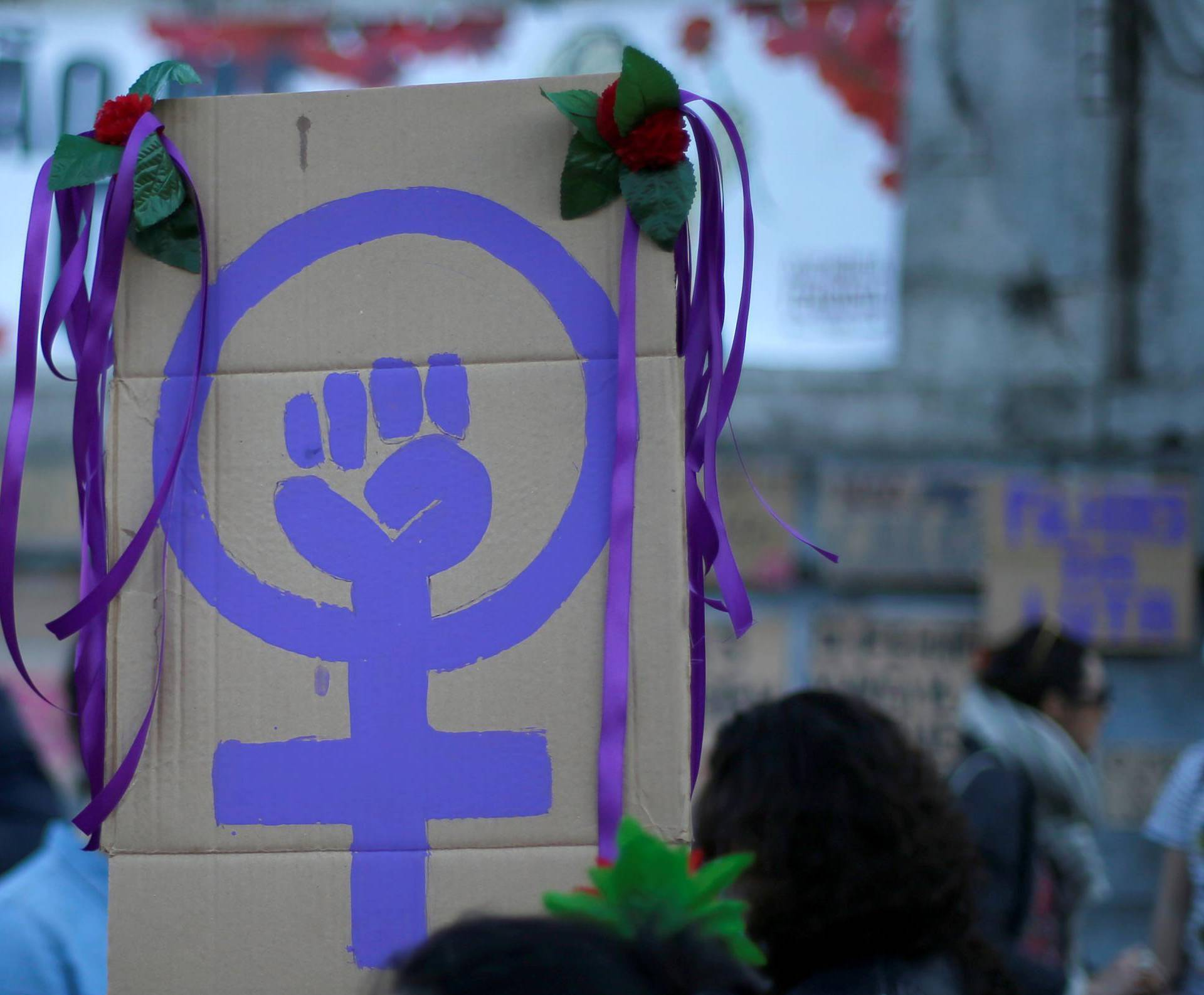 FILE PHOTO: Women attend a meeting to mark International Women's Day in downtown Lisbon