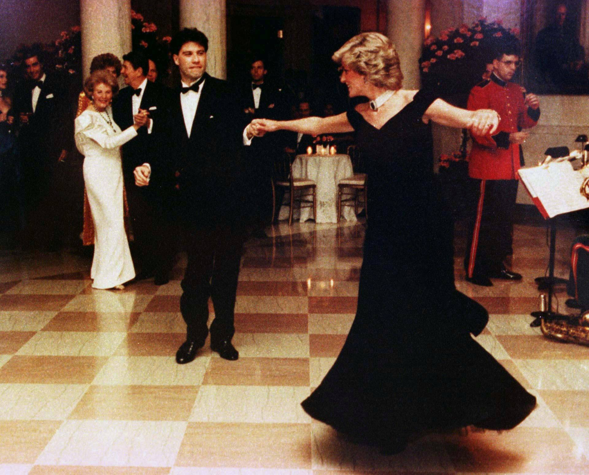 FILE PHOTO: Britain's Princess Diana is shown wearing a Victor Edelstein gown as she dances at a November 9, 1985 White House dinner with actor John Travolta, in Washington