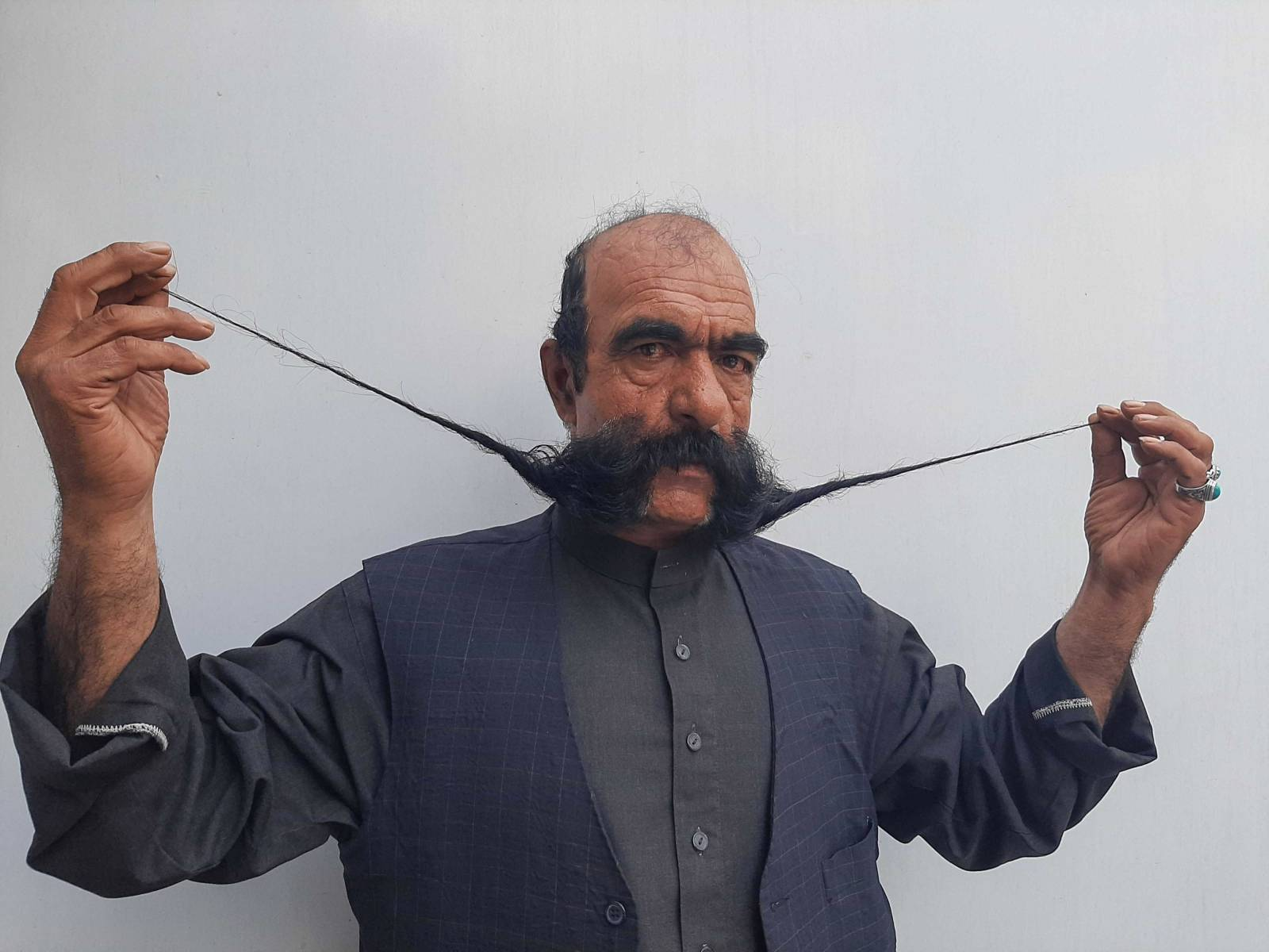 Moustache makes Afghan tailor a celebrity