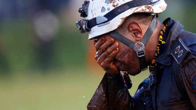 A member of rescue team reacts, upon returning from the mission, after a tailings dam owned by Brazilian mining company Vale SA collapsed, in Brumadinho
