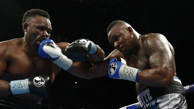 Dillian Whyte (R) in action against Dereck Chisora