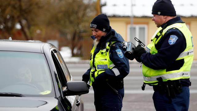 Estonian police officers Hele Truus and Aimar Luik talk to a speeding driver in Parnu