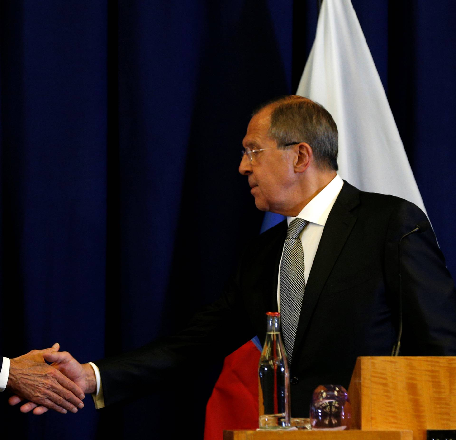John Kerry and Russian Foreign Minister Sergei Lavrov hold a press conference in Geneva