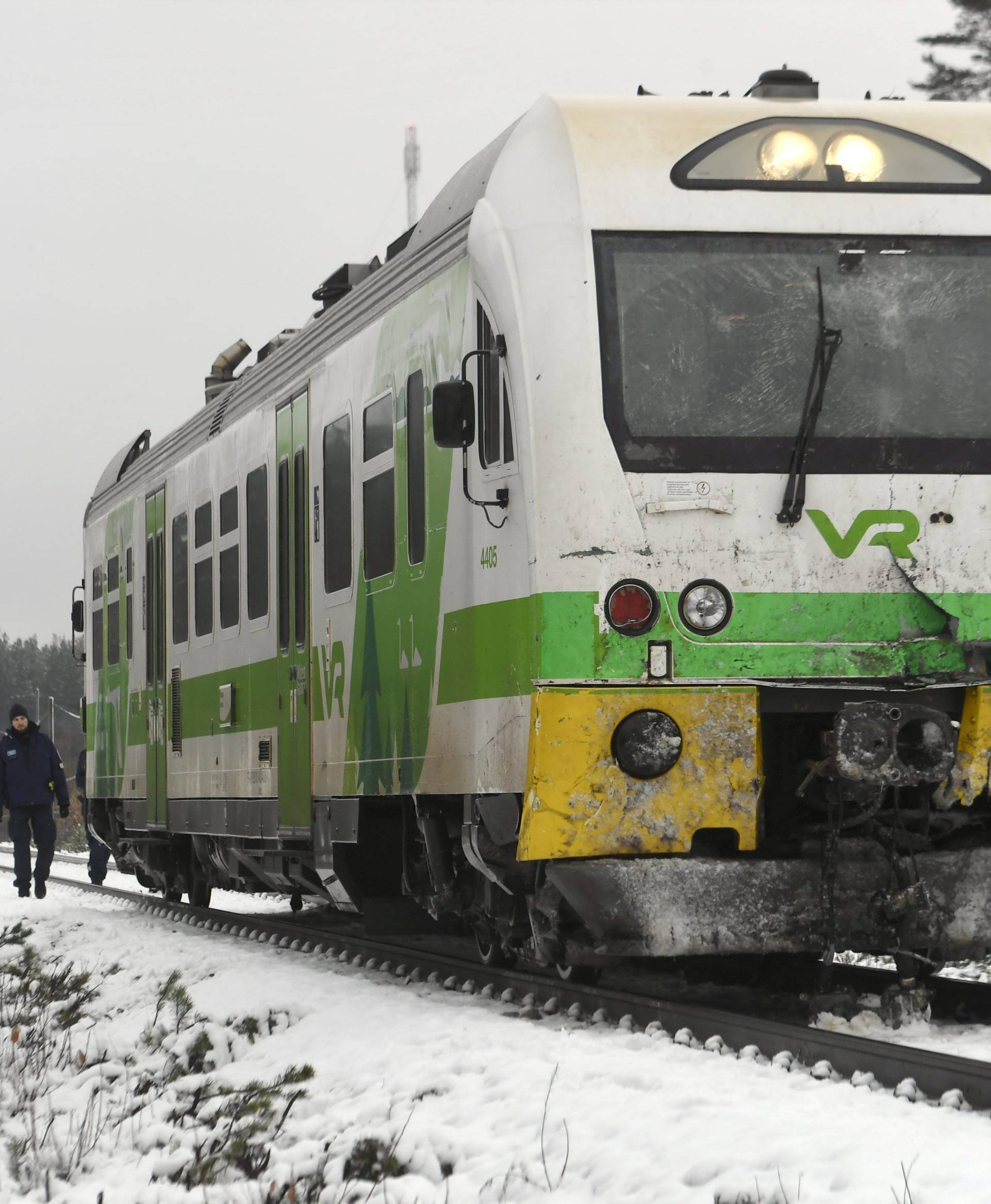 Passenger train near the railroad crossing is pictured after a crash in Raasepori