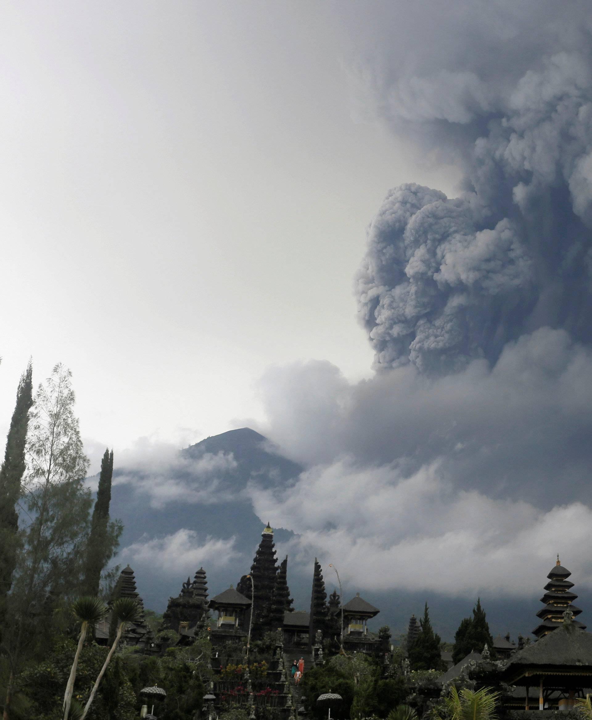 Mount Agung volcano erupts as seen from Besakih Temple in Karangasem, Bali
