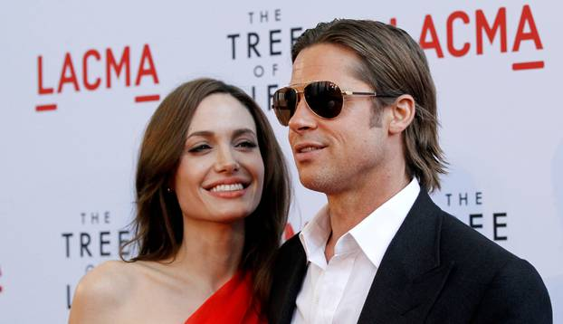 "FILE PHOTO: Pitt and Jolie pose at the premiere of ""The Tree of Life"" at LACMA in Los Angeles"