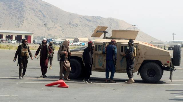 Taliban forces patrol at a runway a day after U.S troops withdrawal from Hamid Karzai International Airport in Kabul
