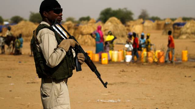 A Nigerien soldier stands guard in a camp of the city of Diffa during the visit of Niger's Interior Minister Mohamed Bazoum following attacks by Boko Haram fighters in the region of Diffa