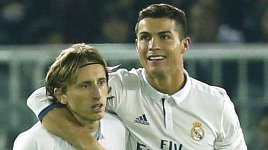 Real Madrid's Cristiano Ronaldo celebrates scoring their fourth goal with Luka Modric
