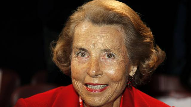 FILE PHOTO: Liliane Bettencourt, heiress to the L'Oreal fortune, attends French designer Franck Sorbier's Haute Couture Spring-Summer 2011 fashion show in Paris