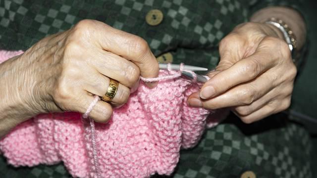 Old woman Knitting at home.