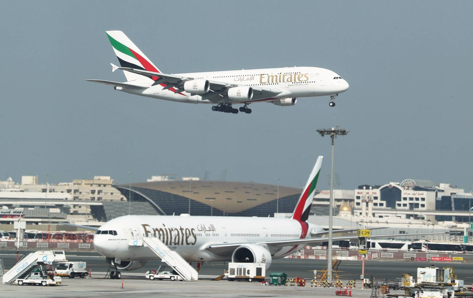 FILE PHOTO: Emirates Airlines Airbus A380 plane approaches for landing at Dubai Airports in Dubai