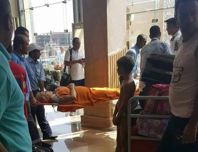 Medics rush an injured tourist at the Zahabia hotel resort, after an Egyptian man stabbed tourists in Hurghada