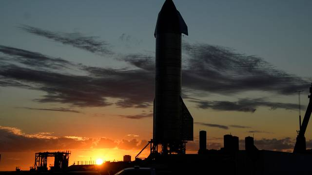 FILE PHOTO: SpaceX prepares their super heavy-lift Starship rocket  for a test launch at the company's facilities in Boca Chica, Texas