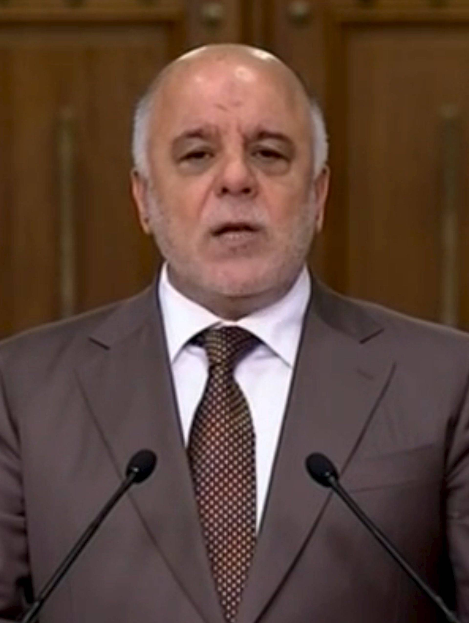 Iraqi Prime Minister Haider al-Abadi speaks during a news conference in Baghdad