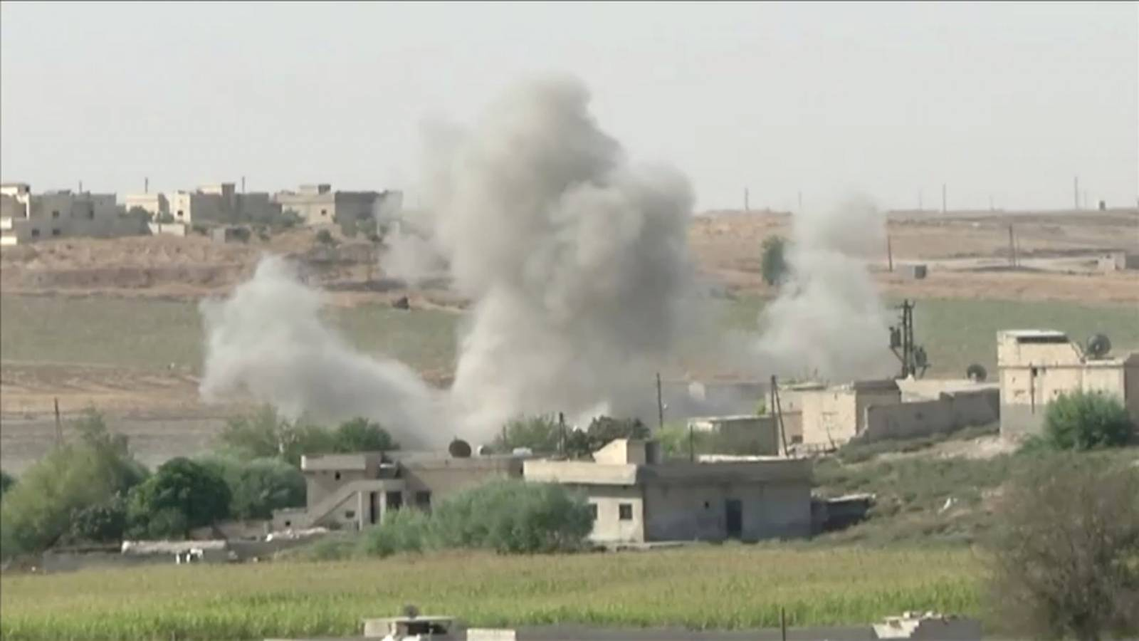 Smoke rises from an explosion during an offensive by Turkish-led forces in Tel Abyad