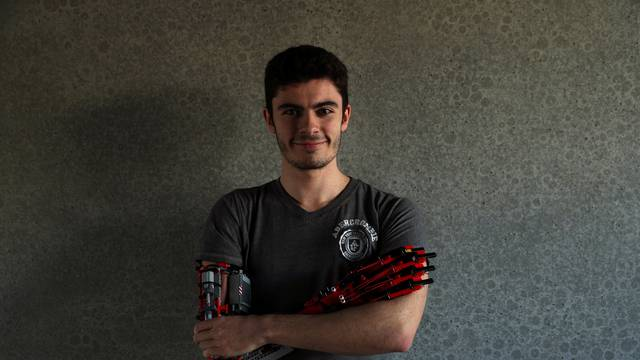 David Aguliar poses with his prosthetic arm built with Lego pieces during an interview with Reuters in Sant Cugat del Valles