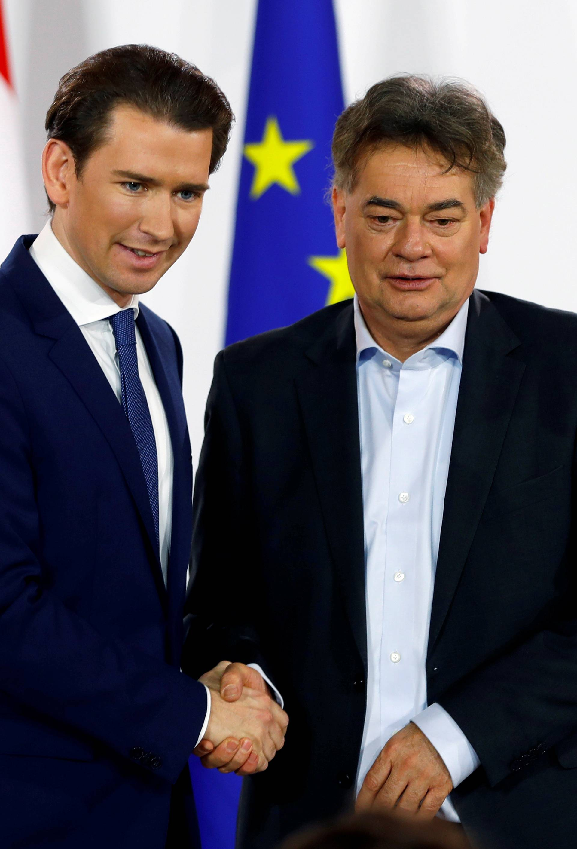 FILE PHOTO: Head of Austria's Green Party Werner Kogler and head of People's Party (OeVP) Sebastian Kurz shake hands after delivering a statement in Vienna